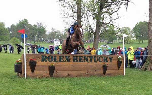 Lillian Heard and Share Option jumping the final fence at Rolex