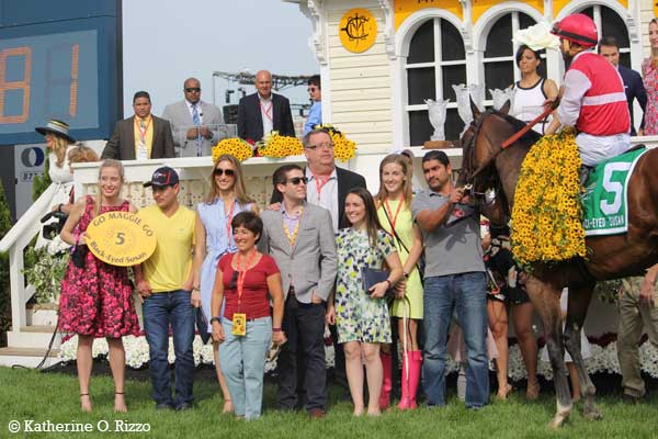 Black-Eyed Susan Stakes winner Go Maggie Go and her connections in the winner's circle