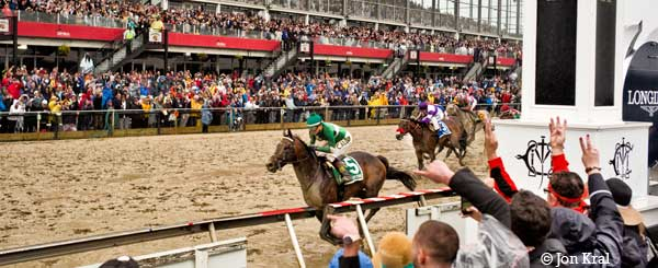 Exaggerator winning the 141st Preakness Stakes in front of a record breaking crowd at Pimlico