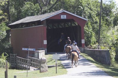 One of Fair Hill's iconic covered bridges - bridges and tunnels for horses and carriages are found throughout the property. Many are still usable today. ©Katherine O. Rizzo