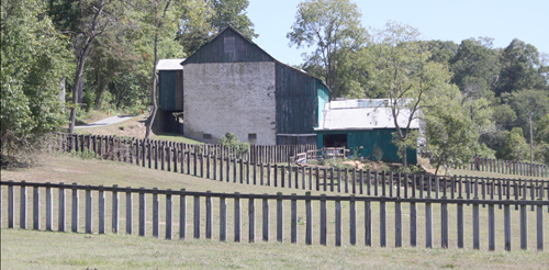 Once used by cattle, these pastures and barns are now rented out to local horsemen and women. The fencing is the same railroad tie fencing first put up in the 1940s. ©Katherine O. Rizzo