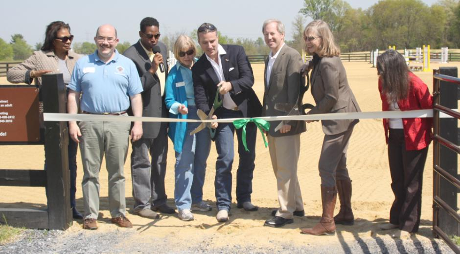 Councilman George Leventhal, Councilman Craig Rice, Coucilwoman Nancy Floreen, Woodstock supporter Aleco Bravo-Greenberg, Coucilman Phil Andrews and Director of Montgomery County Parks Mary Bradford cutting the ribbon to officially open the new riding arena.
