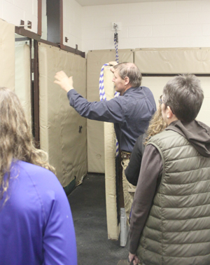 Dr. James Brown shows onlookers one of the padded rooms where horses are anesthetized before surgery.